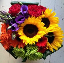 Bright bouquet of flowers, red yellow and purple