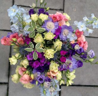 bouquet of flowers including spray roses and Delphinium