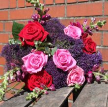 Bouquet of flowers with red and pink roses